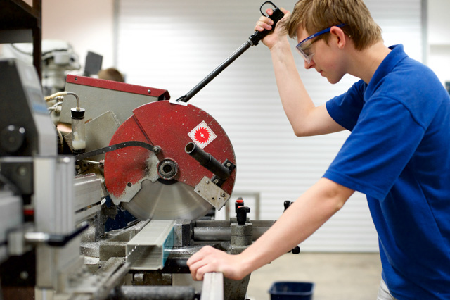 Work Shop Machinist Using Circular Saw